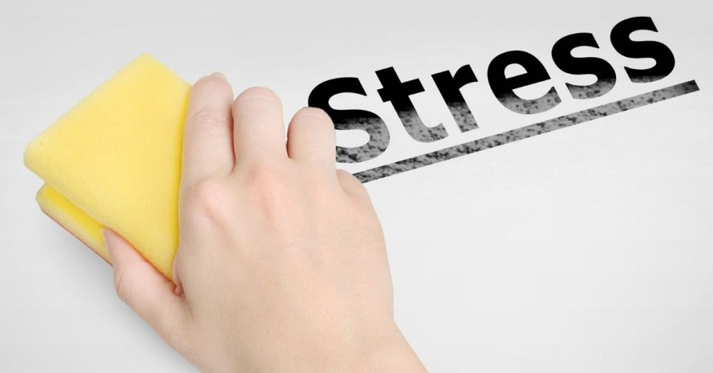 Rubbing out the word stress with a cleaning sponge - can't keep on top of housework