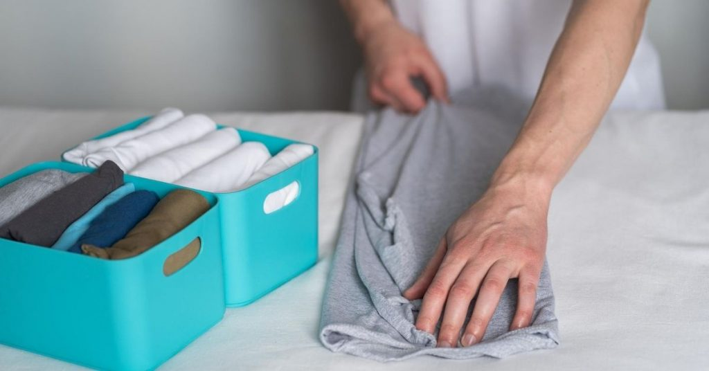 Folding Clothes to make a tidy wardrobe - Clean and Tidy Living