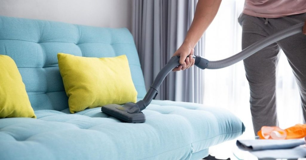 Hoovering a Blue Sofa - Best Vacuum Cleaner Under £200 - Clean and Tidy Living