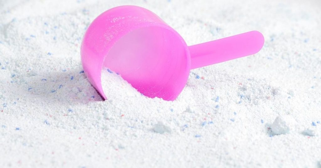 Natural washing powder with a pink scoop - Clean and Tidy Living