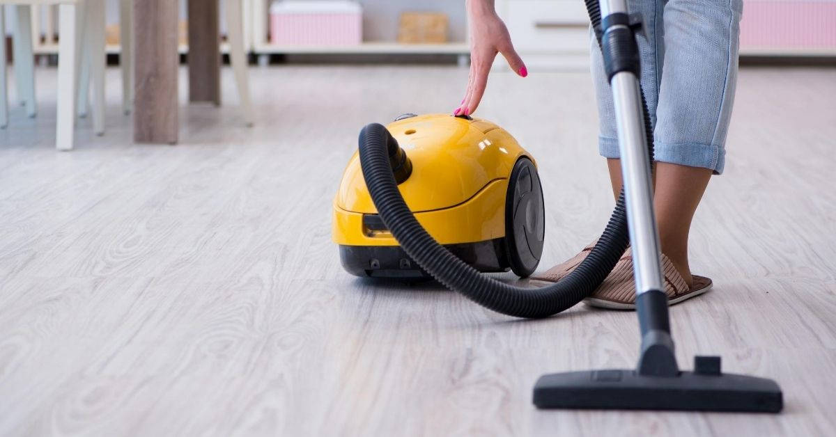 Woman Using a Vacuum to Clean Floor - Best Vacuum Cleaner Under £200 - Clean and Tidy Living