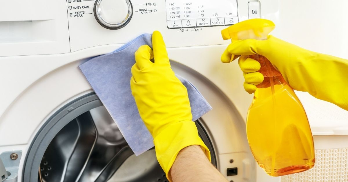 Cleaning a Washing Machine with White Vinegar Spray and a Cloth - Clean and Tidy Living