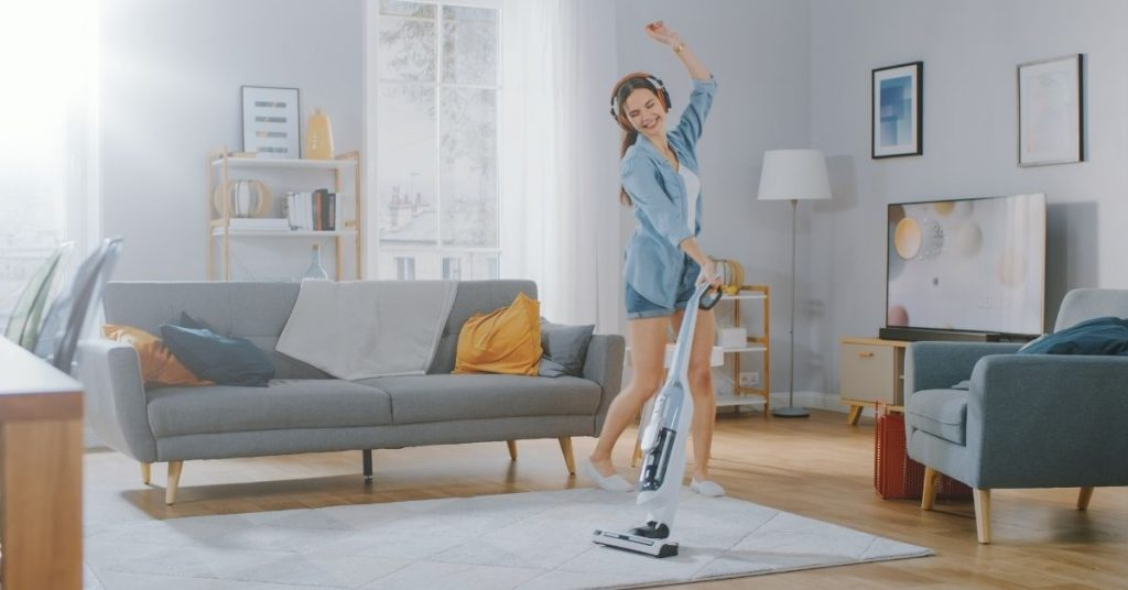 Woman Whizzing Round With a Cordless Hoover Cleaning - Time Saver Tips - Clean and Tidy Living