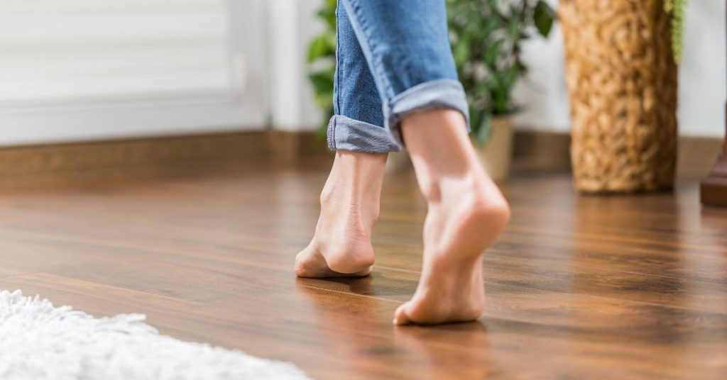 Woman walking on Karndean LVT flooring - Can you steam clean_ - Clean and Tidy Living