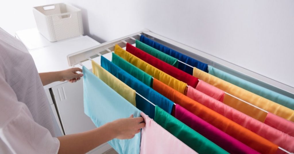 Clothes drying after being washed with the best wool detergent - Clean and Tidy Living