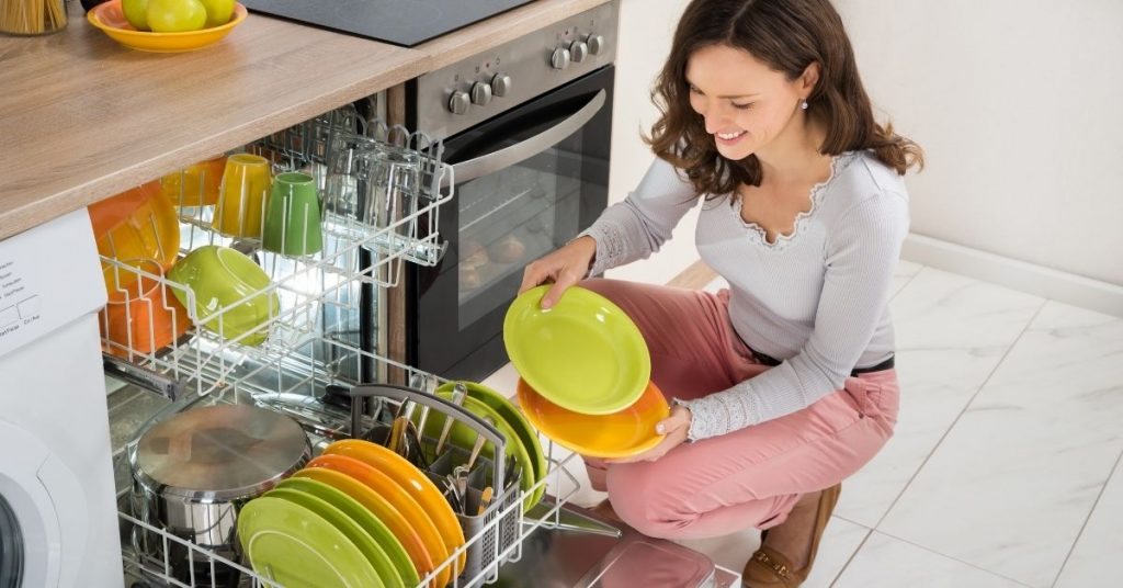 Woman-Unloading-a-Dishwasher-Best-Dishwasher-Under-300-in-the-UK-Clean-and-Tidy-Living