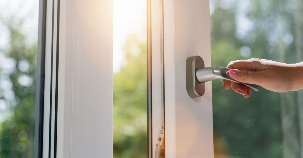 Opening a Window to Stop Your Clothes Smelling Damp - Clean and Tidy Living
